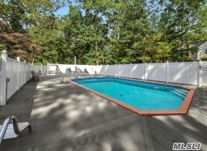 Impeccably Maintained 4 Bedroom 2 Bath Colonial on Cul-De-Sac in Little Woods of Wading River. Heated 18'X36' Inground Pool w/ Trex Deck. Beautiful Hardwood Floors, Solid Wood Doors Throughout, New Interior Paint and 4 Season Sunroom W/Radiant Heat Flooring Are Just A Few Highlights In This Fantastic Home. Silestone Countertops In Kitchen And Bathrooms, Manicured Grounds and Camera Surveillance System.