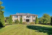 Reminiscent of a French villa, this elegant, sun swept 7, 100-square-foot, six-bedroom, five-and-a-half-bath, brick Colonial is a perfect venue for gracious Gold Coast living and exceptional entertaining. Standing serenely on over two acres of sweeping lawns and formal gardens, it offers an attached three-car garage, circular paving-stone drive, and an immense rear patio with heated inground Gunite pool. Entertainer's paradise with elegance, grandeur, and remarkable architectural interest.