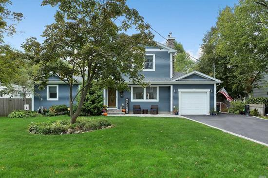 Completely Redone In 2014... 5 Bedroom, 3 Full Bath Home with an Entry Hall, Living Room with Fireplace & Built-Ins, Eat In Kitchen, Formal Dining, Cozy Family Room, Office, Master Suite, Hardwood Floors, Central Air Conditioning, Backyard Patio & Garage... Not to Be Missed