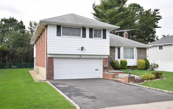 Beautifully & Meticulously Kept Expanded 4 Bedrooms & 2.5 Bath Split Home Located at Midblock Of a Quiet Street In Highly Sought After Clearview Village. Close Proximity to Shopping, LIRR, Transportation. Vaulted Ceiling w Natural Light Filled Living & Beds. Updated Baths, Harwood Floor. Too Many To List.