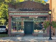 A True Classic- Own A Piece Of Historic Sayville With This Unique Brick Front Building Just Off Main Street. Originally Built in the 1800's This Structure Housed A Dry Goods Store And Since The 1940's Has Been Internationally Known As The Island Fish Net & Supply Company. This Location Offers Convenient Street Parking, High Traffic & Visibility. Just a Block Away From Bustling Downtown Sayville... This Structure Yearns For What Was Once Old To Be New Again.