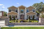 Elegant & Smart Brick Colonial offering over 4418 sq ft. of Luxury Begins at the Foyer.LR W/Porcelain Heated Floors, Eik which flows into Fam/Rm & Formal, Dr/Rm Fbth. Mstr/Ste, w/spa Mstr/Bth W/Jacuzzi, Wl/Closet & Sitting Rm, Office and Beautiful Sun Rm W/Fpl & Lg Windows leads to Huge Yard.5-Family/Brs with Bath/Jacuzzi, TV/Rm & Fiberon/Deck. Full Fin/Bst 8.5ft ceiling all walls Soundproof, W/Bth. Softener Water Filter, Water Sterilizer, AC & Heat Energy Saver. Control your house from your device!
