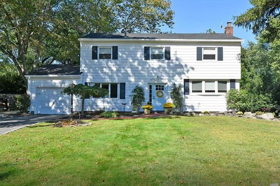 The Desirable College Section! Move Right In To This Beautiful 4 Bed/2.5 Bath Colonial, Perfectly Situated On A Shy Half Acre Property, room for a pool, in Award Winning Harborfields SD. Gleaming Hard Wood Floors, Freshly Painted In & Out, Brand New Roof, Cesspool & Septic Tank, New Cac & IGS. Boasting A Sunny Family Room W/ Fplc, Charming Kitchen W/ Gas Cooking, Energy Efficient Appliances, Granite Counters & Outside Entrance, King-Sized MBedroom & Mbath W/ Skylight. Welcome Home!