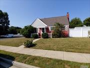 Lovely cape with 4 bedrooms, 2 baths, finishged basement garage OSE Must See !