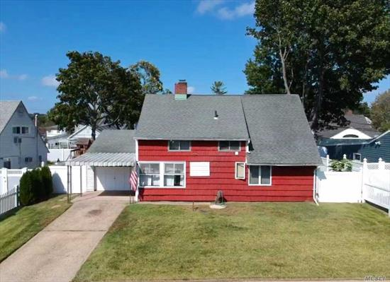 Location! Location! House needs TLC. Lots of space to create your dream home.