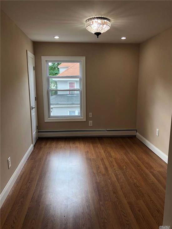 Totally Renovated Two Bedroom Apartment in Locust Valley. Hard-wood Floors, New Kitchen, All Stainless Steel Appliances,  New Bathroom, New Windows, On Site Parking, Locust Valley Schools. Close to LIRR, Glen Cove Hospital and Shopping.