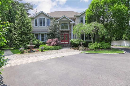Custom Built Colonial In The Heart Of St. James! Features A Grand Ef With Vaulted Ceilings & Waterfall, High End Eik W/ Commercial Grade Appliances, Hw Floors W/Inlay, Fdr, Great Room With Stone Fp & Sliders To Patio, Huge Master Br Suite + 3 Add'l Br's & Ldry On 2nd Fl. Finished Bsmt W/Ose, Summer Ktchn, Separate Living Area & Wet Bar. Country Club Backyard W/ Outdoor Ktchn Under Arbor, 3 Level Paver Patio, 3 Car Detched Garage, Professionally Landscaped Yard, & So Much More! This Is A Must See