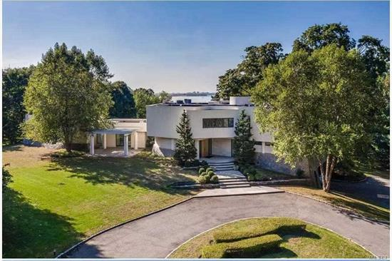A model of modern architecture in Sands Point. Boasting soaring ceilings and walls of glass offering panoramic 180 degrees water views. The highest caliber of construction. Magnificently and privately approached offer breathtaking landscapes and stunning indoor pool surrounded by natural Granite walls & heated fire place. Exterior stone, travertine and stucco.