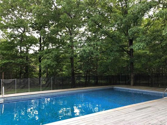 DESIGNED FOR ENHANCED RELAXED ENJOYMENT AND EFFORTLESS ENTERTAINING, INTERIOR DESIGNER'S OPEN CONCEPT CONTEMPORARY IS LOCATED ADJACENT TO A 3 ACRE PRESERVE. WARM, INVITING, COMFORTABLE, 5 BEDROOM HOME HAS FIRST FLOOR EN-SUITE MASTER WITH EGRESS TO POOL, DECK DECO TURF TENNIS , GUEST BR AND BA, OPEN KITCHEN- DINING- GREAT ROOM WITH FIREPLACE. SECOND FLOOR 3 BR, 1 BA. FULL BASEMENT WITH GAME ROOMS, LAUNDRY, WINE RM, DETACHED 2 CAR GARAGE. STRONG RENTAL HISTORY. PERFECT FOR PERSONAL USE OR INVESTMENT.