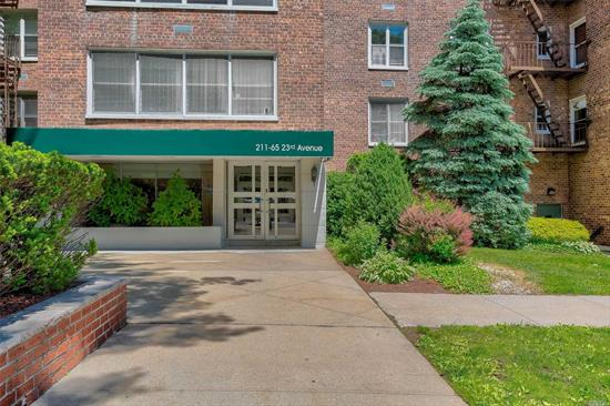 FABULOUS TOP FLOOR CORNER SOUTHERN FACING OVER-SIZED 2 BEDROOM/ PLUS TWO BATHS Apartment features central air and heat , lots of closets, reserved parking and FABULOUS LOCATION~ STEPS TO BAY TERRACE SHOPS, LIBRARY. EASY ACCESS TO ALL MAJOR HIGHWAYS. MINUTES TO THE LIRR, EXPRESS BUS TO CITY AND FLUSHING RIGHT OUTSIDE YOUR DOOR. TOP RATED SCHOOL DISTRICT#25 .A GREAT NEIGHBORHOOD AND FANTASTIC PLACE TO CALL HOME!