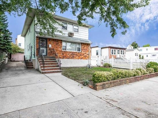 Elmont Colonial. Original Family Owner. 2 Bedrooms Over 3 Bedrooms. Full Finished Basement. New 3 Zone Oil Hot Water Heat. Built As Mother/Daughter. Currently CO'd As One Family.