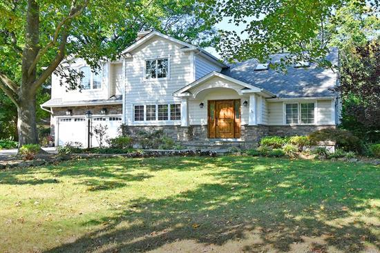 Move right in to this thoughtfully expanded & renovated home. It's all about the fabulous open living space featuring light & bright updated kitchen w large island & enormous (28x22) family room.Beautiful design elements include rich wood floors, vaulted ceilings, stainless steel appliances, granite counter tops, moldings and 2 wood burning fire places. Large wood deck looks out onto lush flat property with sports court. Amazing curb appeal. Low taxes. Half Hollow Hills East