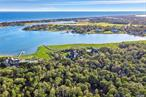 Quogue Village. Level and wooded building lot on 2+/- acres of land. South of Montauk Highway with access via private road. Build your dream home!