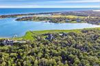 Level And Wooded Building Lot On 2 +/- Acres Of Land In The Village Of Quogue, South Of Montauk Hwy. Tranquil Setting With Access Via Private Road.