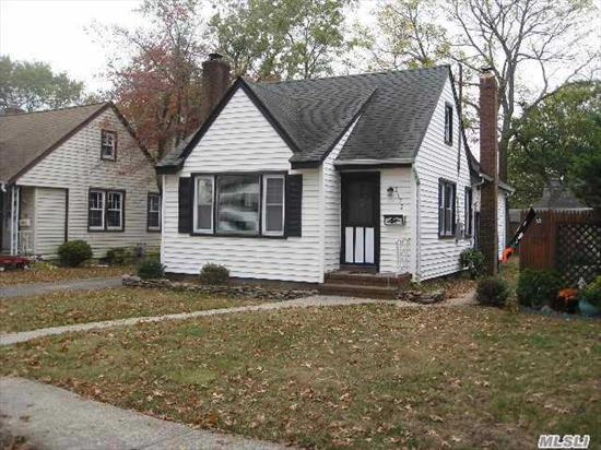 Great Cape In South Merrick Updated Kitchen with Granite Countertops.Updated Bath, Fireplace, Wood Floors.Detached Garage This Cape Is Truly In Great Condition!