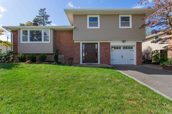 Beautiful, Updated Split Level Home In The Manetto Hills Area Of Plainview. Updated Eat In Kitchen, Updated Full Bath, New CAC, New Roof, New Siding, Sparkling Floors, New Tile, Fresh Paint. MUST SEE! Parkway Elementary, Matlin Middle School