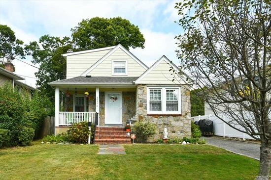 Location, Location, Beautiful and Charming Expanded Cape Home in Merrick Manor Estates. Living Room with Fireplace, 4 Bedrooms, 2 Baths and Fantastic Sunroom. School District #29