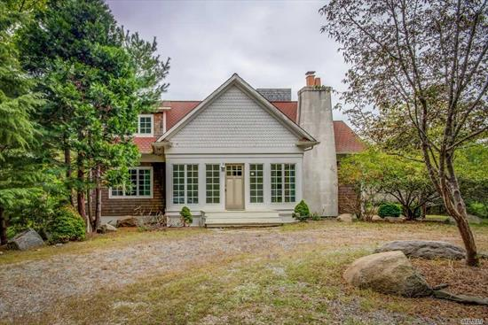 a beautiful spacious home set on approx 7 acres of tranquil private wooded property. Boasts inground pool with pool house and oversized lanai with amazing views. Sun drenched rooms with open flow. Minutes to beaches, shopping, golf ...simply ...the hamptons