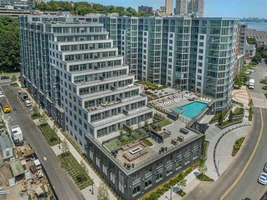 A 20 year tax abatement program on this new construction of 278 residences by K Hovnanian makes this a winner. Come and see exceptional luxurious waterfront living at 9 on The Hudson that are thoughtfully designed with quality crafted details and spacious open floor plans. Home features include 2bed 2bath, over-sized windows, beautiful white oak flooring throughout, Gourmet chefs kitchen with custom Pedini cabinetry, Aspen Quartz counter tops, Bosch and Thermadore appliances, bathrooms with Carrera marble, quartz vanity counter tops and Moen rain shower heads. Exceptional resort style amenities include a 24/7 concierge, a stunning infinity pool with a lounge and BBQ area, 2 floors of state of the art fitness center, golf simulator and a sprawling roof top lounge with a breathtaking panoramic view of the Manhattan skyline. Your ideal next home.