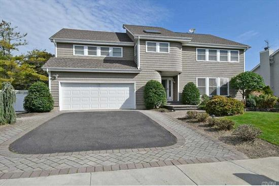 2013 Updated Contemporary home in Prestigious Melville Court features: EIK w/ Brightly lit Sunrm, Granite CTops, Wood Cab., SS Appl., Cent Island & Stone Tile; Sep Wine cooler; Mud/Lndry rm; Family Rm w/ wood Fireplace, LED Lites, Overlooking Balcony & Sliders to yard; MasterSuite w/Updated Bth has porcelain tile, quartz CTops, Jacuzzi tub, Sep Shower w/3 showerheads & WIC; wd Flrs & HiHats thruout; 3 Skylites, 2 Car Gar & 150amp elec. HOA Dues $170/month w/ access to community pool & clubhouse