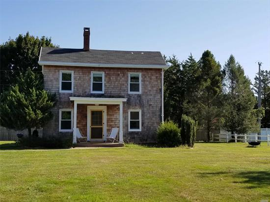 Stylish and Charming Updated Farmhouse with Water Views and Private Beach Rights.