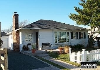 Rent this adorable 2 Bedrm,  2Bath Cottage, 1 block to a beautiful beach.