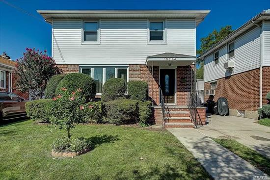 Very spacious property conveniently located in Fresh Meadows, district 26 schools. Open and bright space features an expansive eat-in kitchen, sun-filled living room with over-sized windows, formal dining room, half-bath, master bedroom with full bath on first floor. The second levels features 3 large bedrooms and a full bath. Basement is finished with own separate entrance.