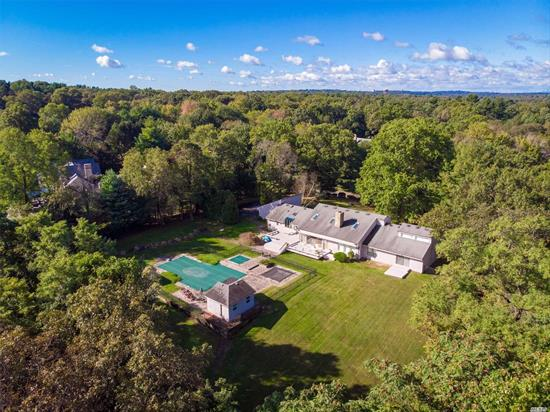 Perfect location in the estate area, and bordering the majestic Muttontown Preserve, this spacious home with soaring ceilings, a towering stone dual fireplace and a fabulous open floor plan can accomodate an extended family. The serene and beautiful grounds serve as the backdrop for the gunite pool & spa, a kids' pool, and a fully equipped cabana. An expansive master suite on the main level, amazingly low taxes, and an eco-friendly heating system makes this is an unpararalled value