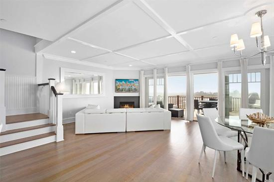 If design, quality and spectacular views are what you are looking for, look no further. This oversized bayfront Townhouse offers top-of-the-line construction with all of the most desirable amenities. The 3, 200 sq. ft. home includes 4 bedrooms, 3.5 baths, 2 fireplaces, garage, basement space and multiple decks, including top-floor deck with hot tub and views of the bay. Enjoy maintenance-free living in this gated community with private beach, boat slips, heated pool, clubhouse and so much more.