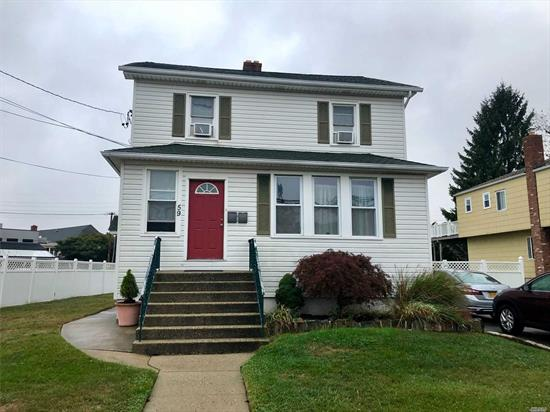 Beautiful & Charming 2-Bedroom Apt on First Floor of Home w/ Basement & Yard in Lynbrook SD#20! This Apt Boasts A Nice-Size EIK w/ Dishwasher& Pantry, Refinished Hardwood Flrs Thruout, Freshly Painted, Large Unfinished Basement w/ Washer/Dryer & Plenty of Storage, Large Fenced-In-Yard, 2-Car Parking in Driveway (Side by side with other tenant), Water & Landscaping Included, Small Dog or Cat Allowed with Landlords Approval & 1 Block to LIRR & Village Stores...Wow!
