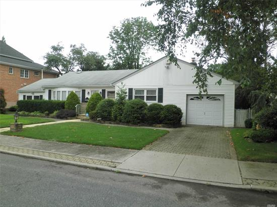 Spacious Ranch on Oversize Property. Large Rooms, Bright and Sunny, Well Maintained Great Opportunity for Expansion. Beautiful, private yard. Central Alarm. Convenient access to Highways, LIRR, Stores, MTA, New Hot Water Heater. CAC not in working order.