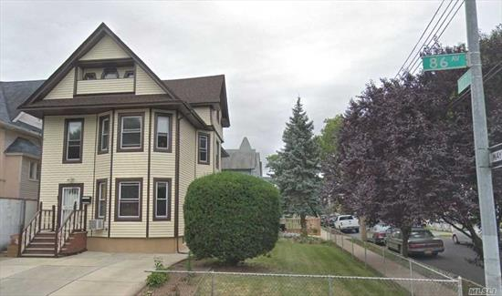 Rare Corner Legal 3 Family Home with Lot 50x100, Building 22x48. Total 2601SQF. 2 Floors plus 1 Large Attic. Private Driveway. Detached Garage. Well-Maintained. New Roof and frame (recently update). Walking distance to Subway J, Z Train, bus, shopping, schools.