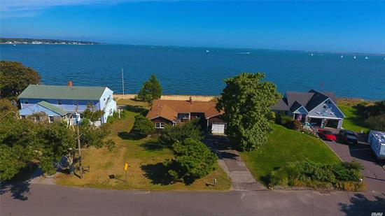 Welcome to Holiday Beach. Are you looking for a waterfront home with breathtaking views? Well look no further, this ranch with 78 feet of frontage along Moriches Bay is exactly what you've been searching for. Offering an open floor plan with eat-in-kitchen, living room w/fireplace, sun room, master suite, guest room, full bath and tandem one car garage. Private beach and docking rights! *New denitrification septic system*