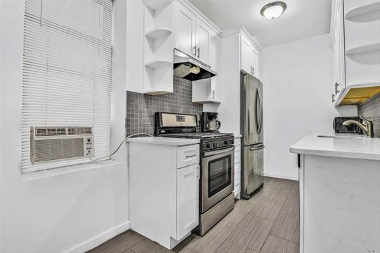 Beautiful Renovated Studio made into a One Bed Condo. Open Living and Kitchen floor Plan, Hardwood floors,  Great location Close to Subway close to LIRR. Perfect Starter Home , Great Investment!!!
