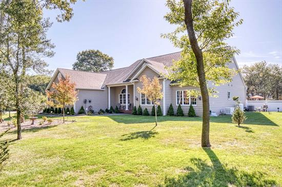 Magnificent custom 2800 sf. ranch in the heart of East Moriches! Just 3 minutes away boating ramps and beaches. This home has it all! Nestled on a very private, park like 1.45 acres. This home boasts 3 BR's with master suite including 2 walk in closets, 3 Full BA's Formal DR and HUGE family room over looking an amazing gourmet kitchen with an 11Ft center island that seats 16! Professional Sub Zero refrigerator and Viking Stove with double ovens. Full Finshed basement with 3-4 BR's plus den.