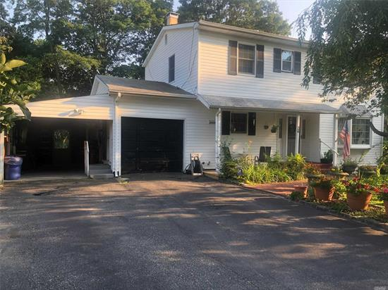Spacious 4 bedroom colonial, 2 full bathrooms, den, living room plus Florida room. Full basement with outside entrance. Upstairs bathroom and Florida room recently remodeled. Well manicured corner lot