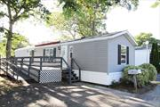 Newly renovated top to bottom, light and bright 2 Bed, 1.5 Bath 2001 Skyline 14' x 60' vinyl sided home w/ large deck w/ ramp. Separate shed on property for storage. 55+ community. Common charges incl. Rent, Tax, Garbage & Snow Removal, Water, Sewer & Maintenance = $790.59. Near to downtown Riverhead with its plentiful shops, restaurants, entertainment, waterfront & professional offices. Easy access to both the North Fork Vineyards & Farms and the Hamptons! Great value for this beautiful home!