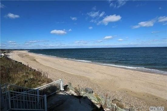 Spectacular Waterfront Property With Breathtaking Sunrises And Sunsets Over Long Island Sound. Bright And Pleasant Home With Generous Window Views Of Serene Ocean And Crab Meadow. Open Floor Plan Featuring Wood Mode Granite Kitchen, Living Room With Stone Fireplace, Great Room, Vaulted Ceilings, Deck And Brick Patio. 44.11' Of Sandy Beach.