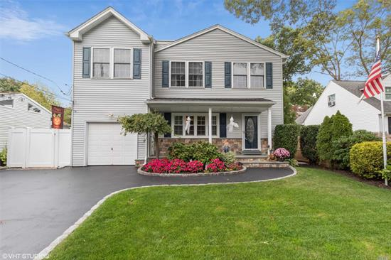 Move right in to this well maintained colonial w/ open floor plan, 5 year old kitchen w/ss appliances, finished basement w/ full bath OSE, maintenance free backyard, huge BRS, all updated windows, seller will convert garage back to garage if buyer wants. easy access to shopping/parkways. A MUST SEE!