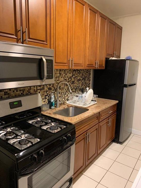 Beautiful 2 Bedroom Apartment for Rent in Glendale. Features Living Room/Dining room, Eat-In-Kitchen with Stainless Steel Appliances, and 1 Full Bathroom. Washer and Dryer Included. Hardwood Flooring Throughout. All Utilities Included. Convenient to Shops and Transportation. Nearby Buses: B12, B20, Q39, Q55, QM24, QM25, QM34. Nearby Train: L, M