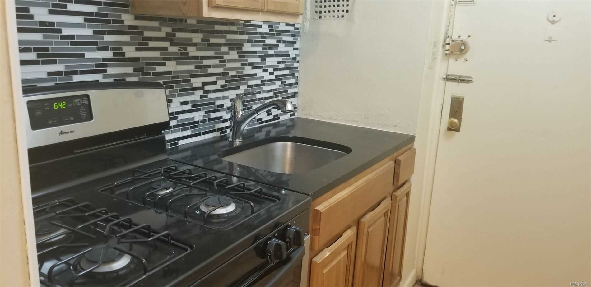 This Co-op Features a Studio Unit, Full Bath, Kitchen and so much more. Co-op is renovated and is in excellent condition. Indoor parking and 24 hour gym available for fee. Walking Distance to Major Transportation & Shopping. Less than a mile from St. John's University.