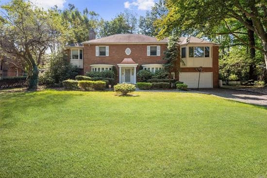 Situated on almost half an acre of flat land, this 4, 050 sf elegant CH Colonial has a new gourmet kitchen by a famous designer, a classic living room, formal dining rm, skylighted family rm, wood-paneled sunlit den, 5 large bedrooms w/ new wood floors and 4 full baths. Additional bonuses: generator and solar panels. Manicured backyard w/ large brick patio is ideal for entertaining and leisure. Close to park, library, and train station, all while still enjoying your privacy and solitude.