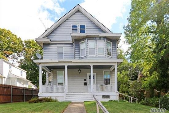 Classic, Turn of the Century, Mid-block Colonial. Original wood work in tact, original fireplace in LR, Tall, high ceilings on both first and second floor. Full, Walk-Up staircase to attic. 2 Car- Detached Garage.