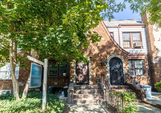 Amazing oversized Brick Townhouse w beautiful wood burning fireplace, hardwood floors, very large rooms, 2 car garage, rear 2nd floor balcony, Anderson windows throughout.tons of charm and detail. Short distance to Q11, Q53, Q52, M, R trains.