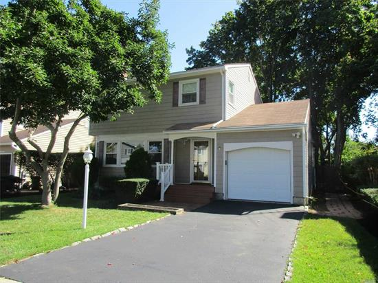 Expanded Colonial W/HW Floors, CAC, Gorgeous Fenced In Yard. Easy Access To Train And Shopping, 4 Seasons Room W/Heat, Den W/Sliders To Patio, Full Basement, Great Taxes! A MUST SEE!