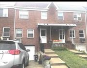 Updated all brick attached colonial, 3 bedroom, 1.5 bath, eat , in kitchen, formal dining room, sun room, full finished basement, attached garage , beautiful oversized back yard