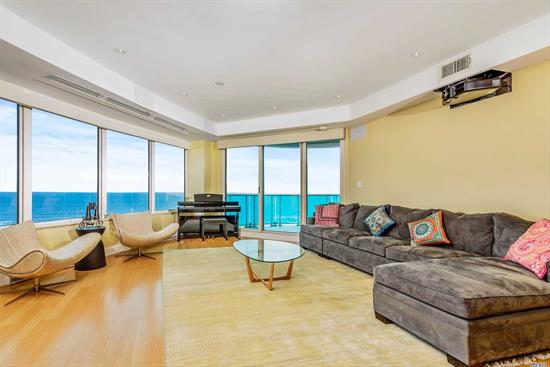 4 Bed, 2.1/2 bath condo locatd. in Long Beach, LI; Furniture Opt. Corner unit w/ south facing ocean views. Pvt. elevator to unit. Open kitchen/dining/living rm w/ 110 projector TV. 2 Lg outdoor terraces connect to living rm, den & master bed. Custom walk-in closet. Hi-res built in TV in master bath as well as marble tub and steam shower. Open kitchen has Italian slate tile, stainless steel appliances. Laundry rm. Savant wi-fi soundsystm in every rm. Apt comes w/ 2 handicap parkng spots. Must see