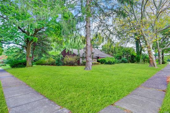 Opportunity to renovate and have your dream home in a very prestigious community on a beautiful corner property!