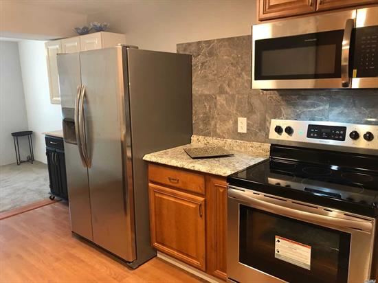 Beautiful 2 Bedroom, 1 Bath Light Filled 1st Floor Unit. Newly Updated EIK w/ Stainless Appliances. Large Living Room w/ Fireplace And Sliders To Patio.