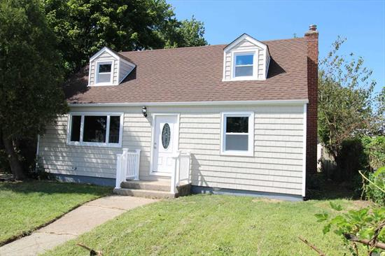 Totally Renovated Cape, Features, Formal Living Room, With Gleaming Hardwood Floors, Eat In Kitchen With White Oak Cabinets, S/S Appliances, Quartz Counter Tops, Ceramic Tiles, 4 Bedrooms, 2 Full Bath, Full Finished Basement W/OSE, Huge Family Room, New Roof, New Vinyl Siding, Long Drive Way, Huge Over sized Yard.
